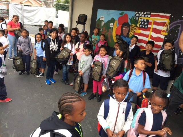 Students at backpack giveaway