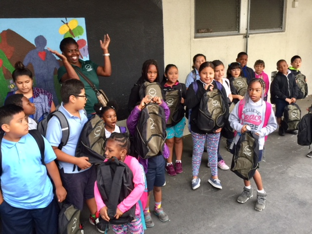 Students at backpack giveaway with PMHCC members